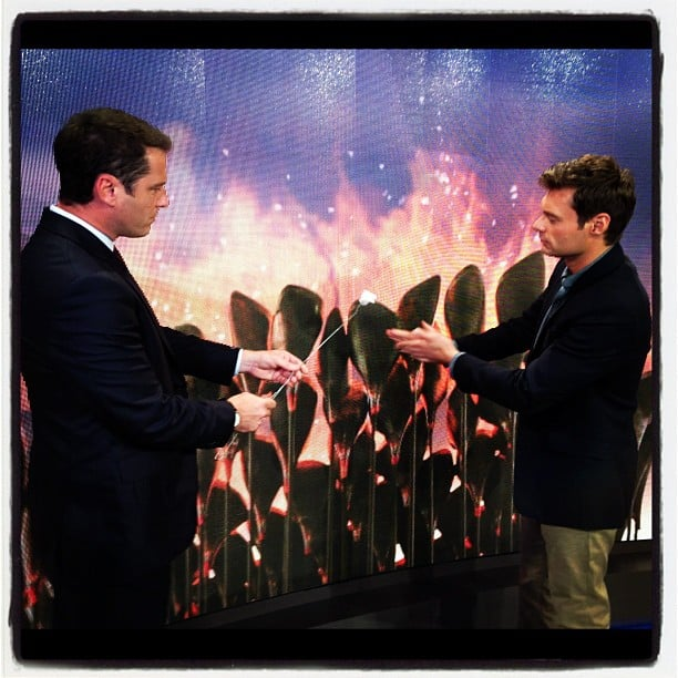 Karl Stefanovic and Ryan Seacrest toasted some marshmallows in the Olympic flame. Source: Instagram user ryanseacrest