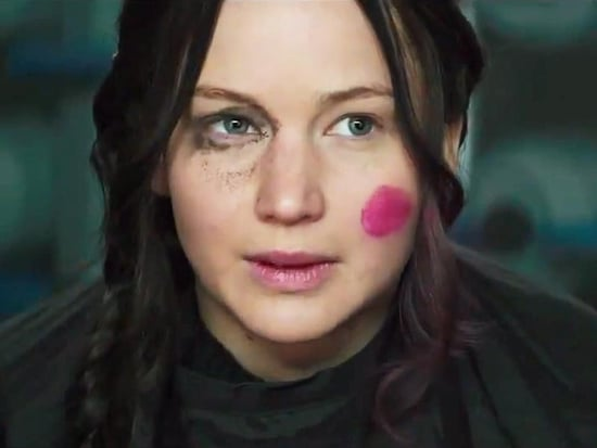 Effie Perfects Katniss's Mockingjay Look 'for Cinna' in Never-Before-Seen Hunger Games Clip
