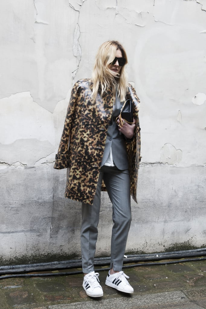 Sneakers with suiting? Why not! Camille Charrière's Adidas shoes punch up a standard suit (as does her leopard coat!) for a day in or out of the office.