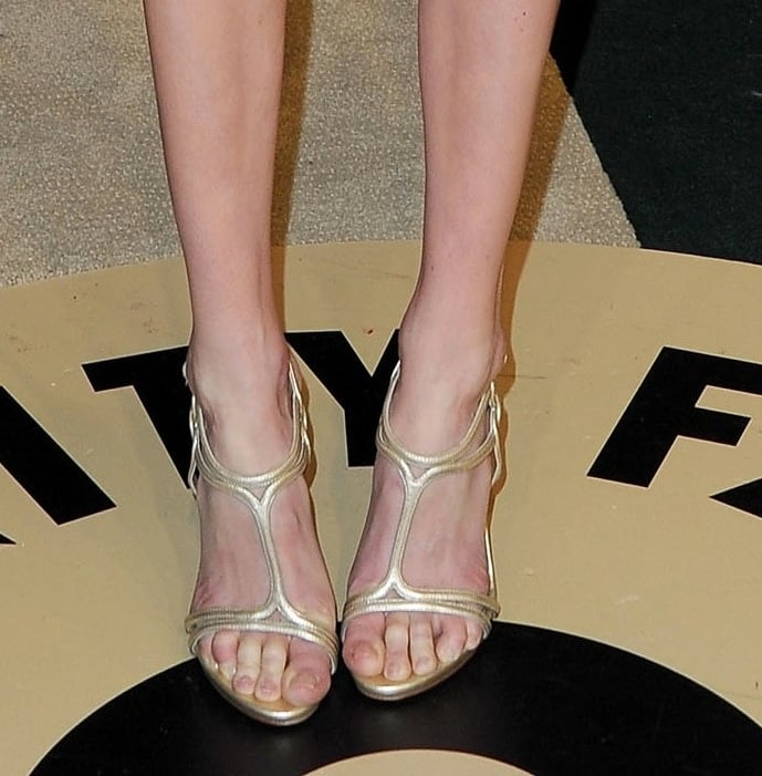 Kate Bosworth's floral Giambattista Valli dress was complemented with a pair of gold T-strap sandals.