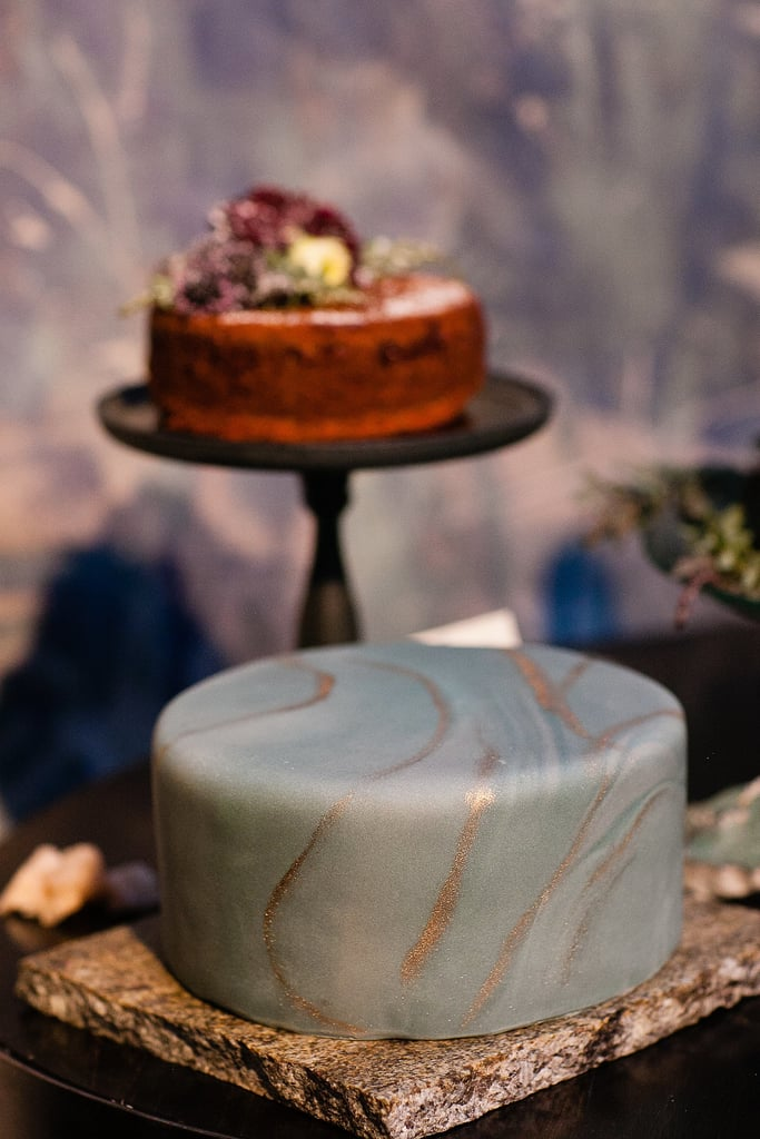 This cake combines both classic and modern elements with smooth marbled fondant and a hint of shine.