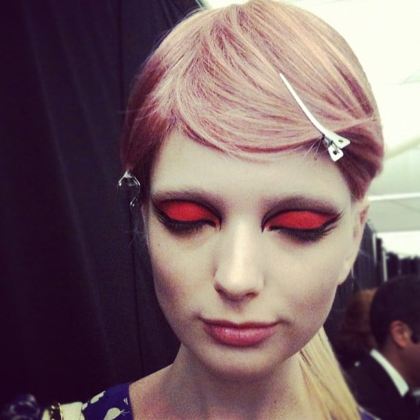 Graphic eyeliner, pastel toupées, and a bold eye shadow encompassed the look at Anna Sui.