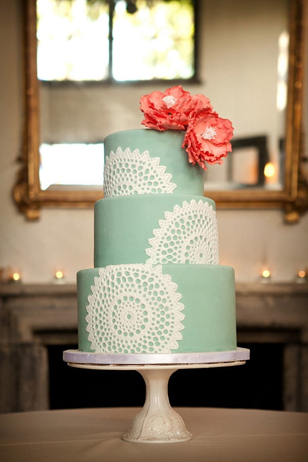 Pairing citrus-colored flowers against this mint-and-white cake is pretty genius (and ultrafeminine) if you ask us.   Photo by Laura Ashbrook Photography via Style Me Pretty