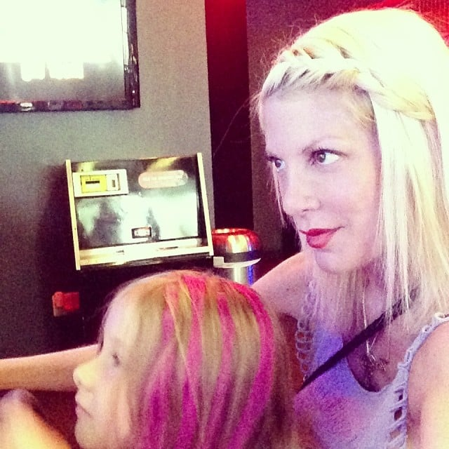 Tori Spelling spent a rainy day at the arcade with a pink-haired Stella McDermott. Source: Instagram user torispelling