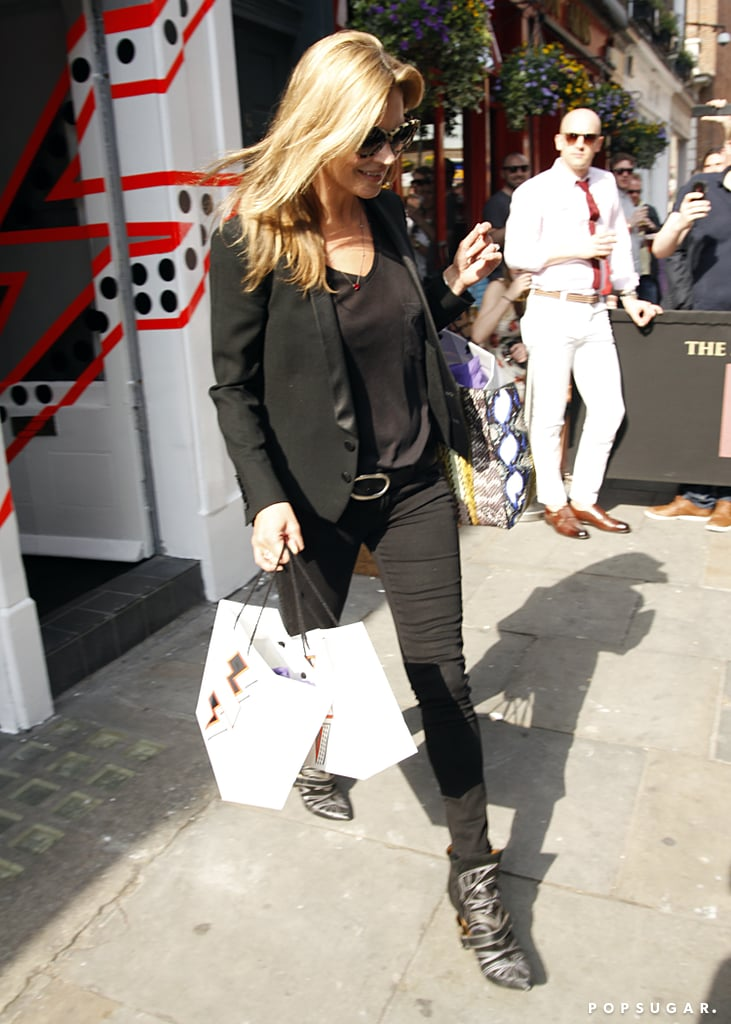 Kate Moss left the store carrying large bags.