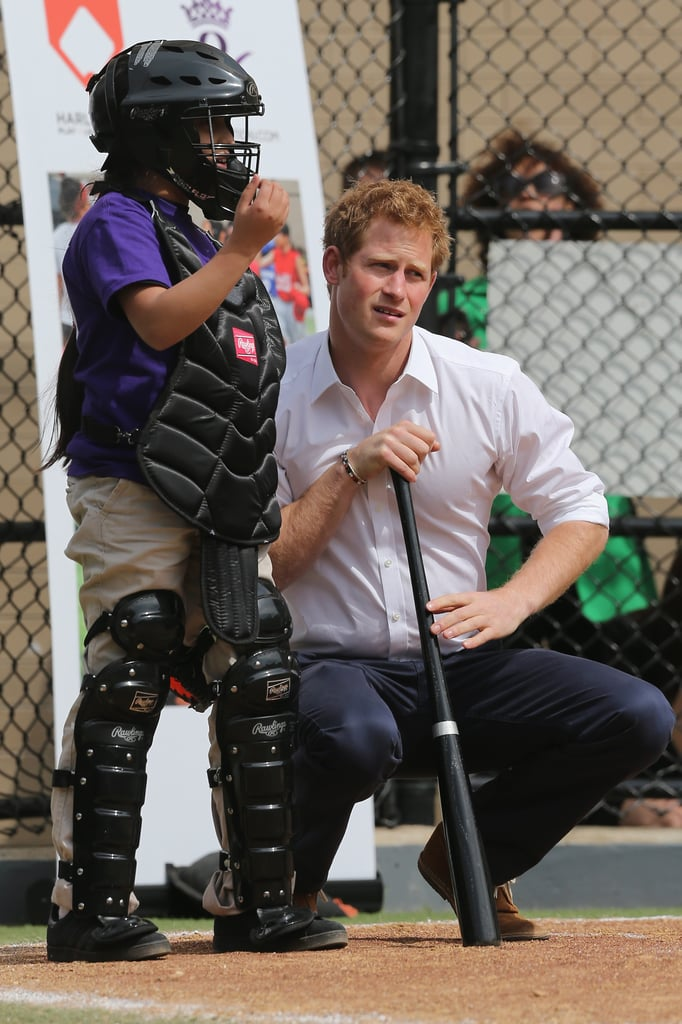 Prince Harry chatted with a catcher on Tuesday while playing baseball in NYC.