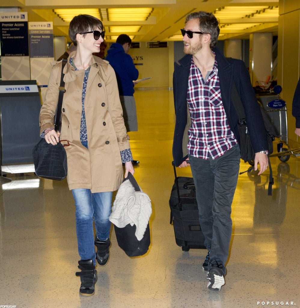 Anne Hathaway and Adam Shulman caught a flight out of JFK.