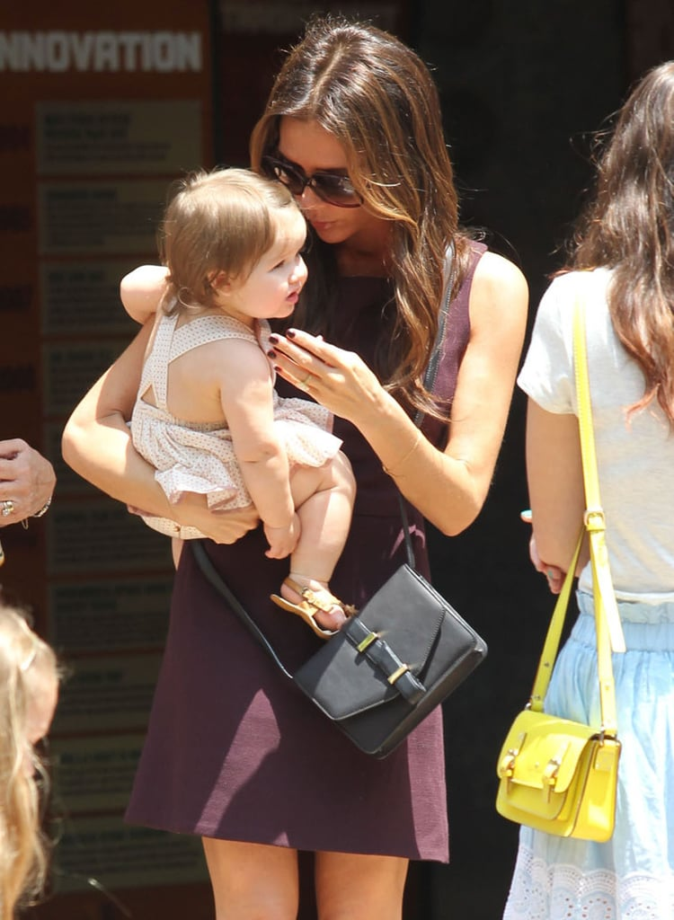 Victoria Beckham snuggled up to daughter Harper during a shopping trip in June 2012 in LA.