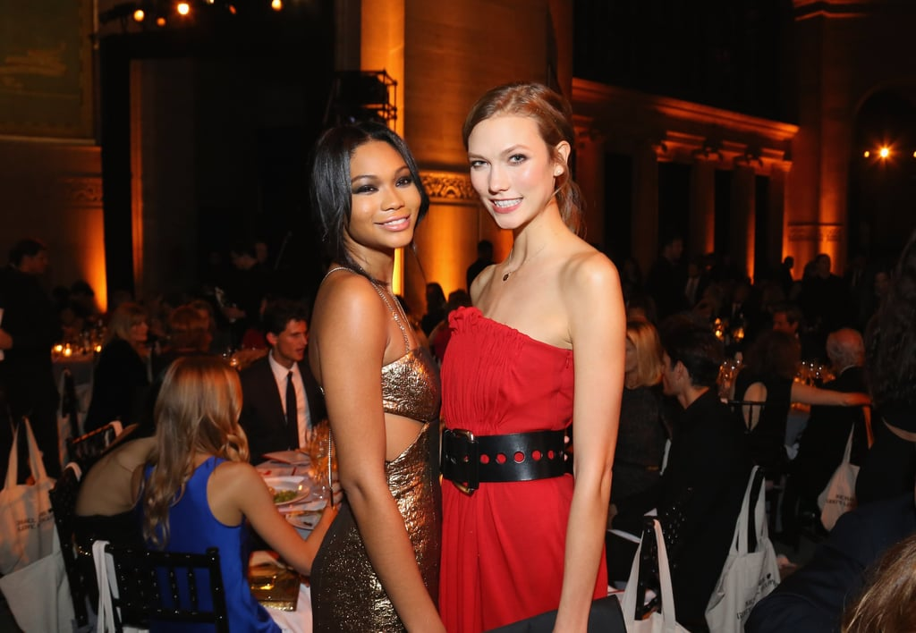 Stylish BFFs Chanel Iman and Karlie Kloss posed together inside the Golden Heart Gala — and while we love Chanel's gold cocktail number, we're kind of obsessed with Karlie's sultry crimson wool dress and wide belt combo. It feels very Fall to us.