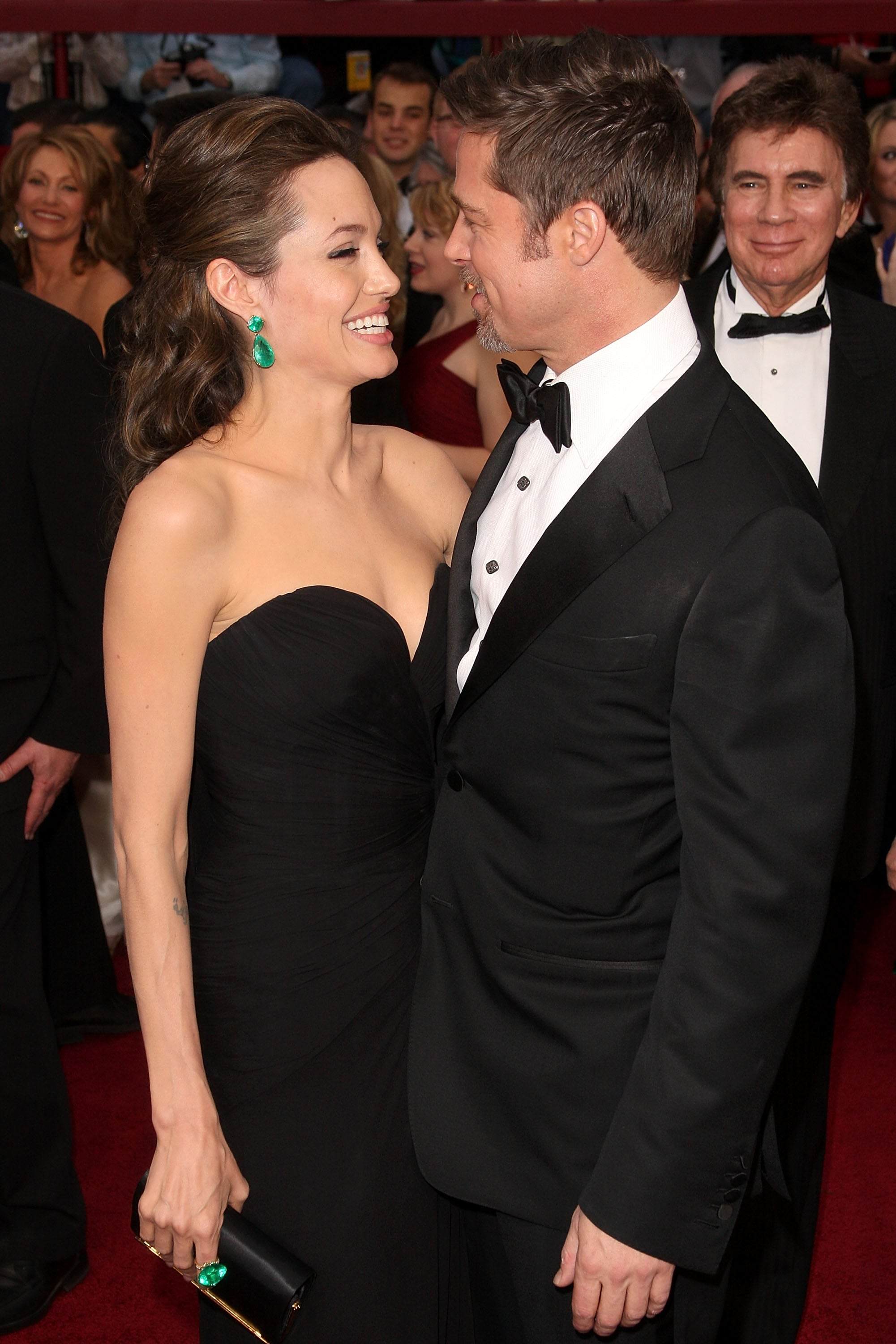 Angelina Jolie flashed a smile in Brad Pitt's direction at the 2009 Oscars.