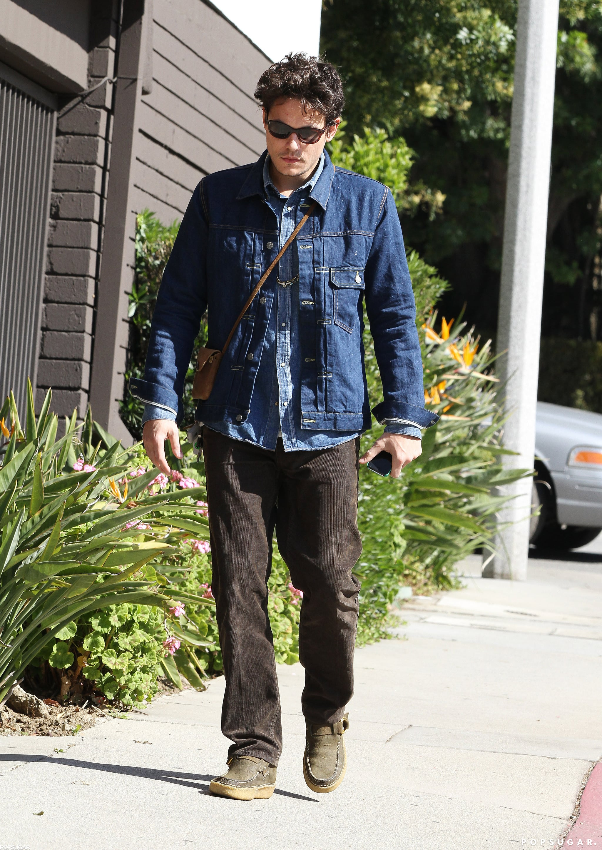 John Mayer sported a pair of shades.