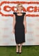 Alice Eve wore a midi-length formfitting black dress that also featured a sexy cutout at the neckline.