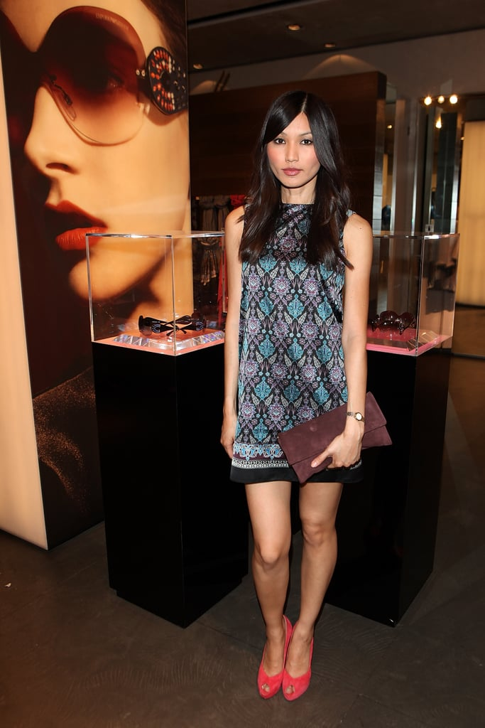 At Emporio Armani's Summer party, Gemma Chan paired her printed shift with colorful extras.