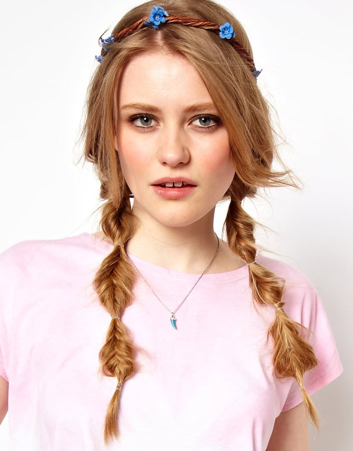 Embrace your inner flower child with Rock 'n Rose's Forget Me Not Floral Garland Headband ($41). The tied-off, pigtailed, and fishtailed braids are pretty ace too.