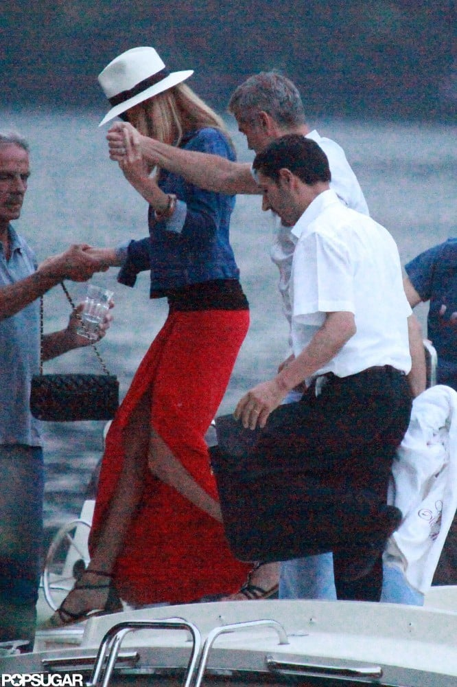 George Clooney gave Stacy Keibler a hand in Lake Como in June.
