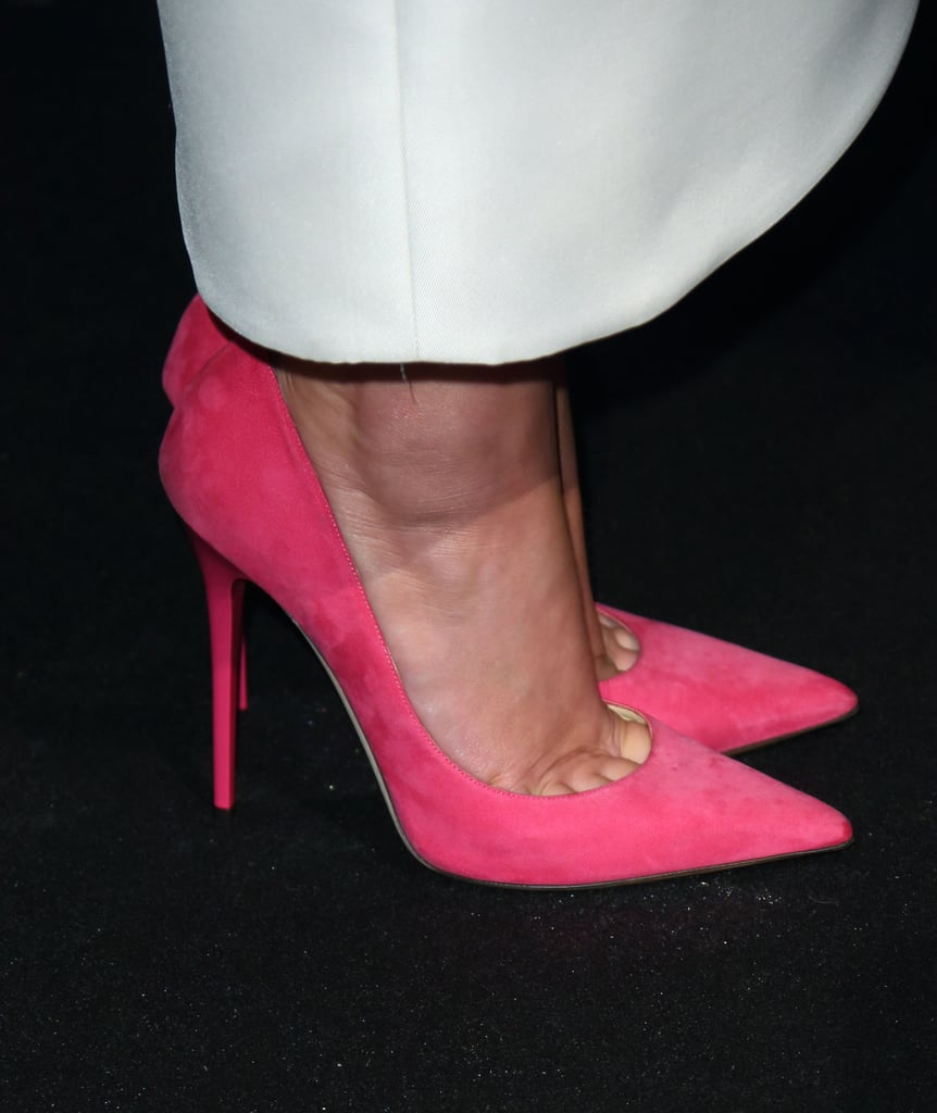 Jennifer Lawrence wore bright pink Jimmy Choo pumps.