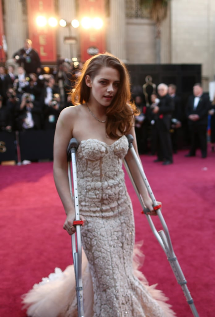 Kristen Stewart got around on crutches.