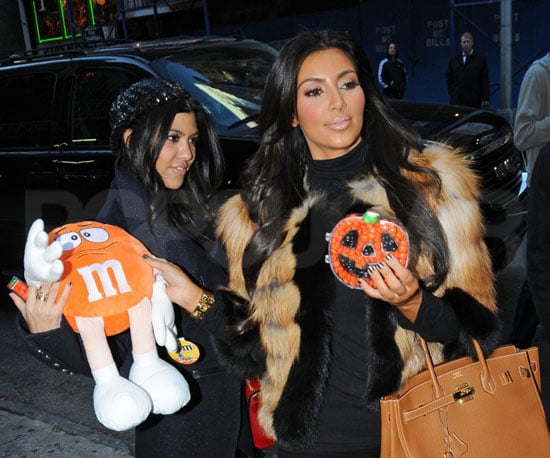 Slide Picture of Kim and Kourtney Kardashian Buying Halloween Candy