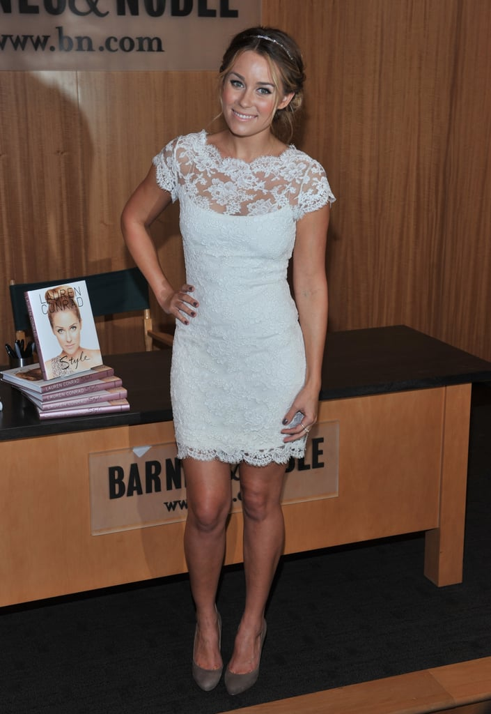 LC looked adorable in this white lace dress from Notte by Marchesa, at a signing of her Sugar and Spice and Lauren Conrad Style books in NYC in October, 2010.