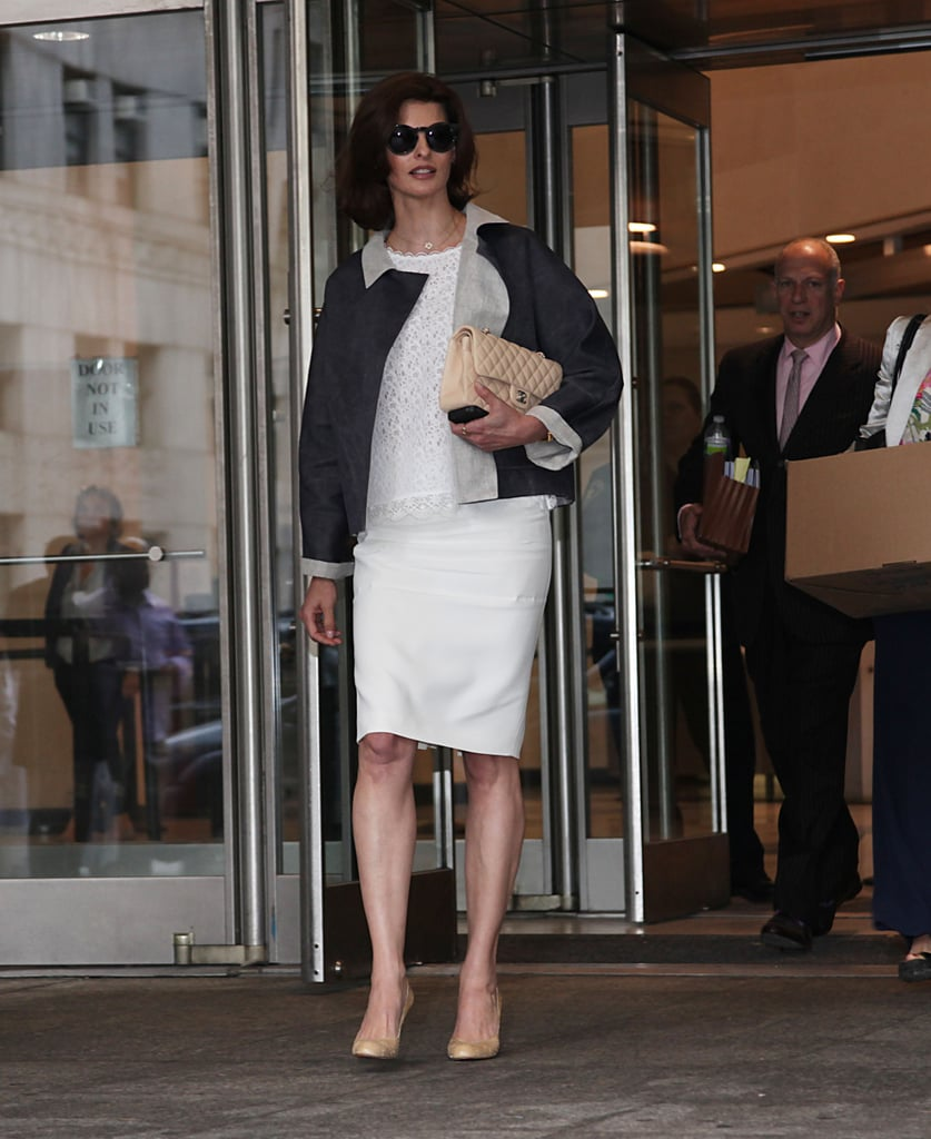 On day two, the supermodel opted for a lighter look: a white lace top with a white pencil skirt, finished off with another pair of round shades, a Chanel bag, and nude pumps.  6848970