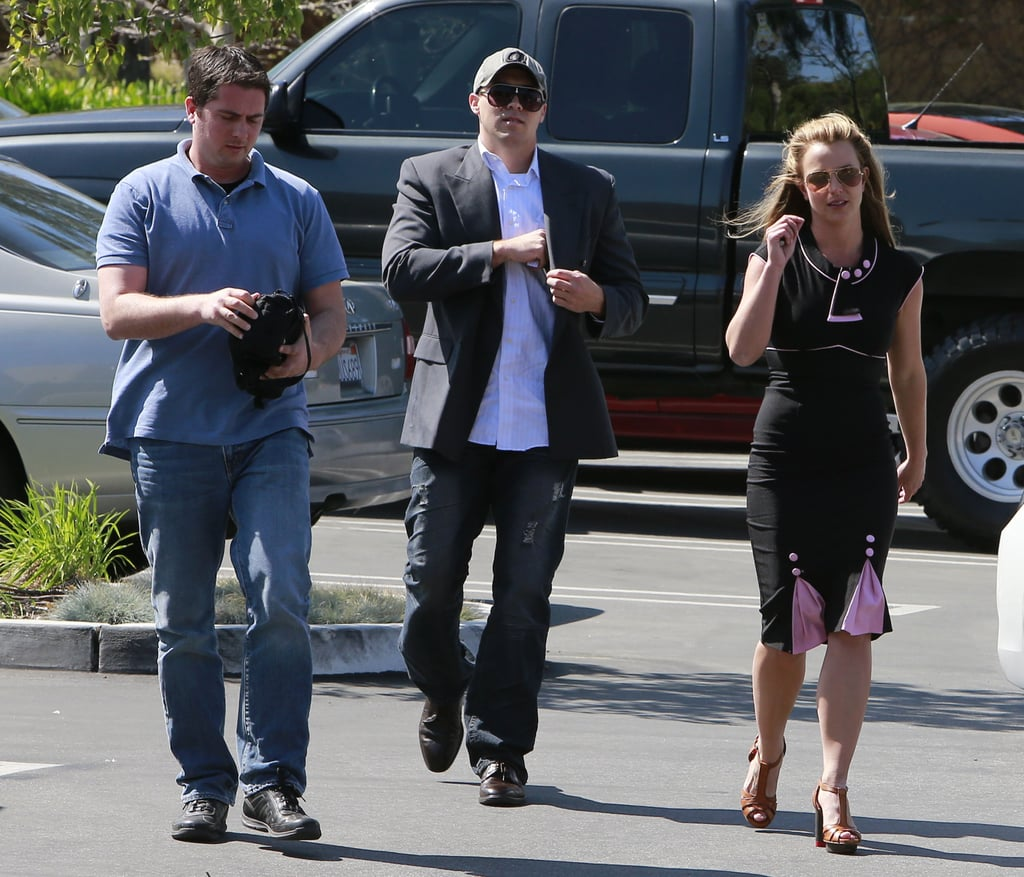 David Lucado and Britney Spears made their way through a parking lot together.