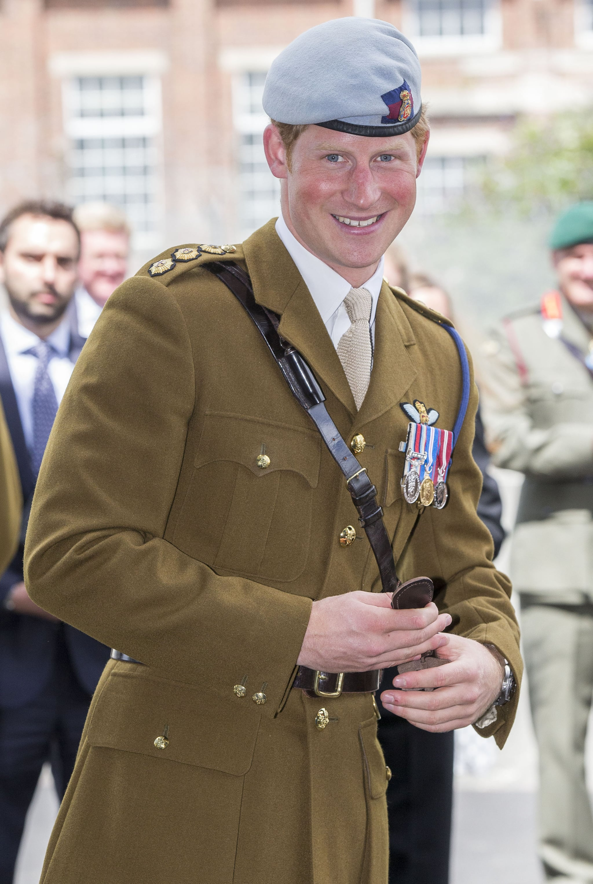Prince Harry flashed a grin after cutting the ribbon to open a new center at the naval base in Devonport, England, in August 2013.