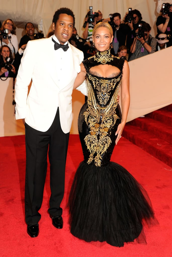 At the 2011 Met Gala in NYC, Beyoncé looked exquisite in a black-and-gold Alexander McQueen gown while Jay Z looked sharp in a white tuxedo jacket.