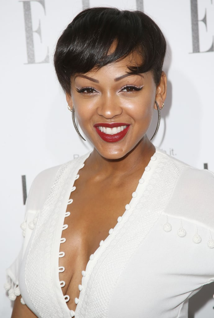 Meagan Good showed off her new cropped hairdo with a classic winged eyeliner and a dash of a white accent. She completed the look with a vampy brick lip color.