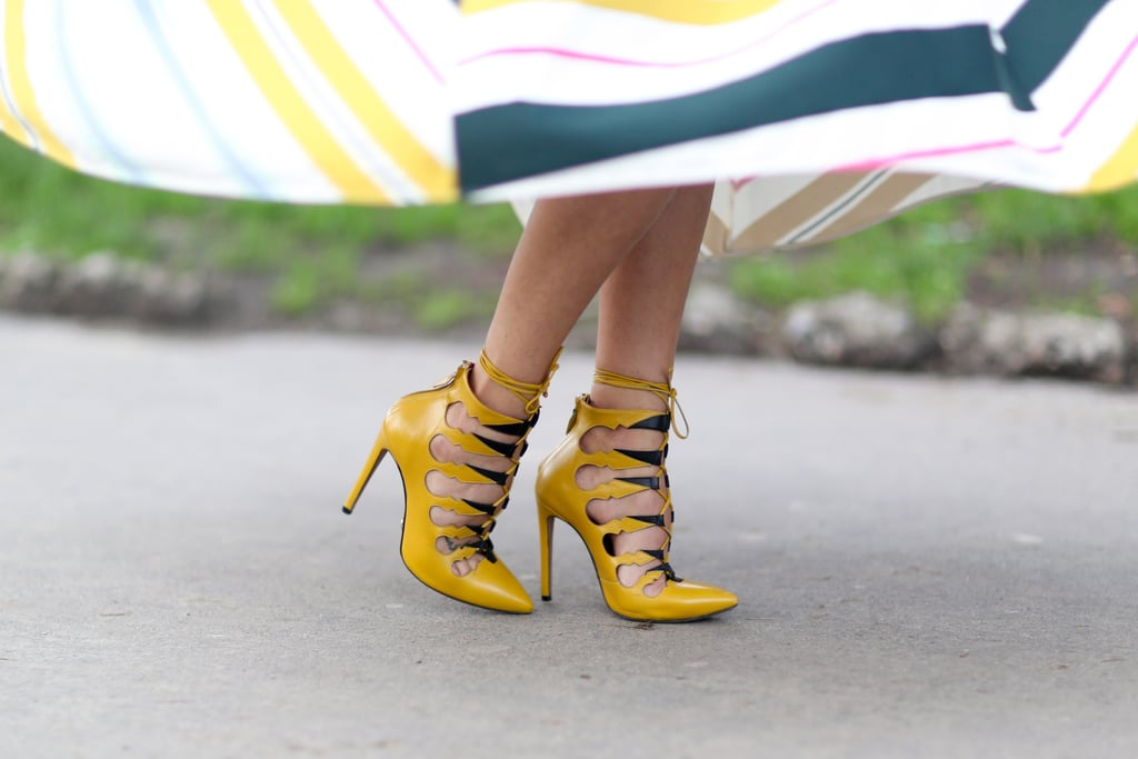 Her totally on-trend lace-up heels also packed a bright color punch.