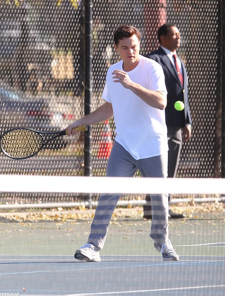 Leonardo DiCaprio aimed his racket at the ball.