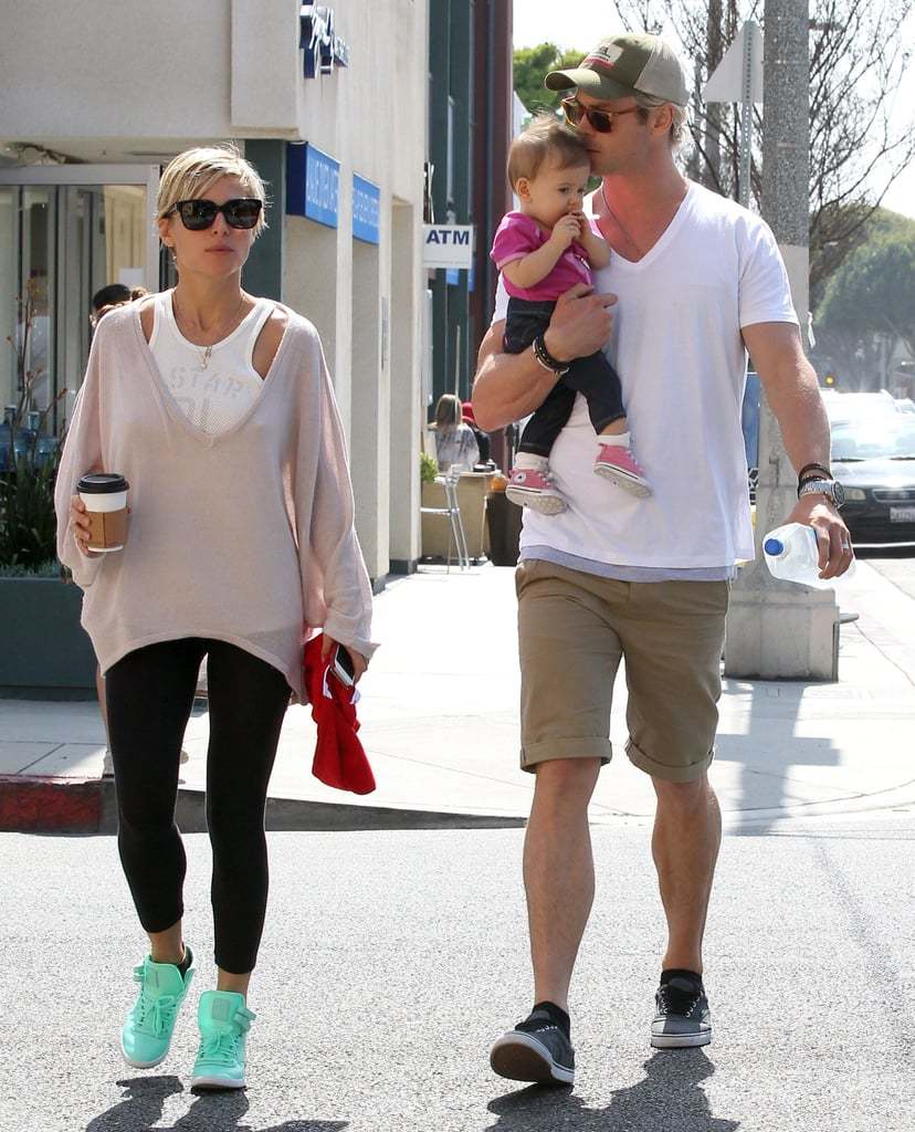 Chris Hemsworth planted a kiss on his daughter, India, after grabbing breakfast as a family with Elsa Pataky in LA Saturday.