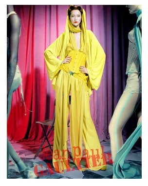 A bright yellow hooded gown and corset are par for the course in the Jean Paul Gaultier Spring 2012 ads. Source: Fashion Gone Rogue