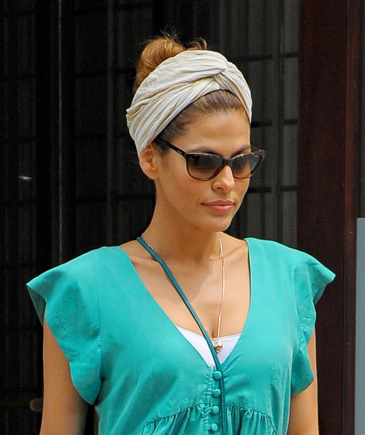 Eva Mendes tried a casual-cool combo that's perfect for beating the heat: a top knot and a turban.