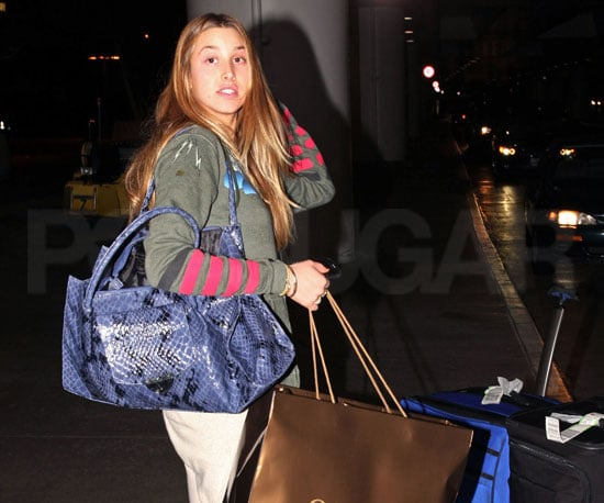 Slide Photo of Whitney port at LAX with Bags