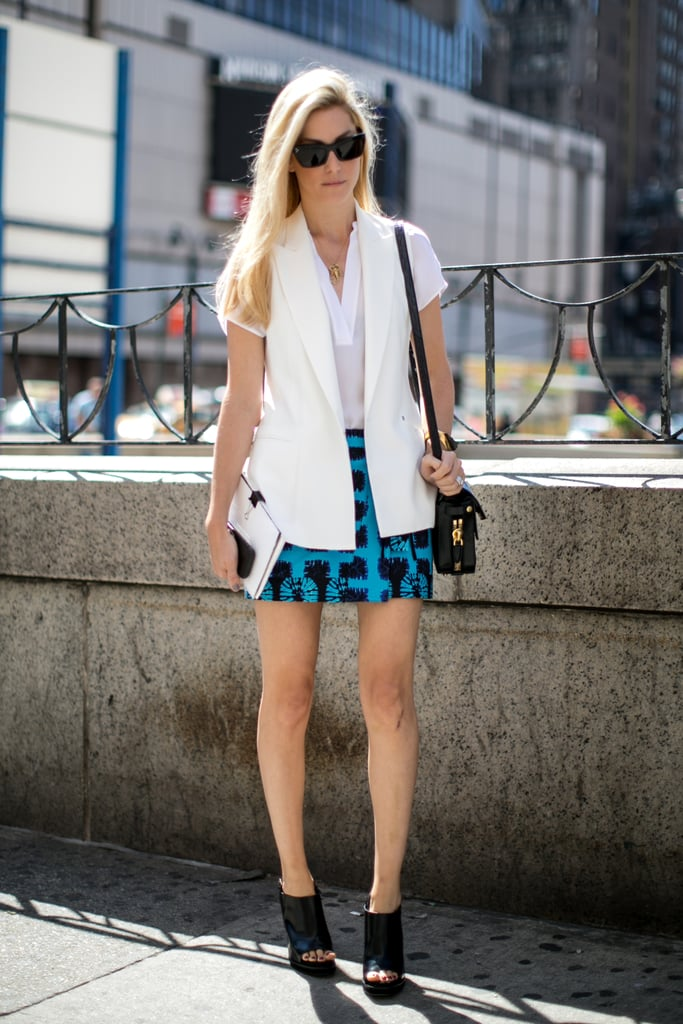 Signature cool from Joanna Hillman in a white vest and printed mini.