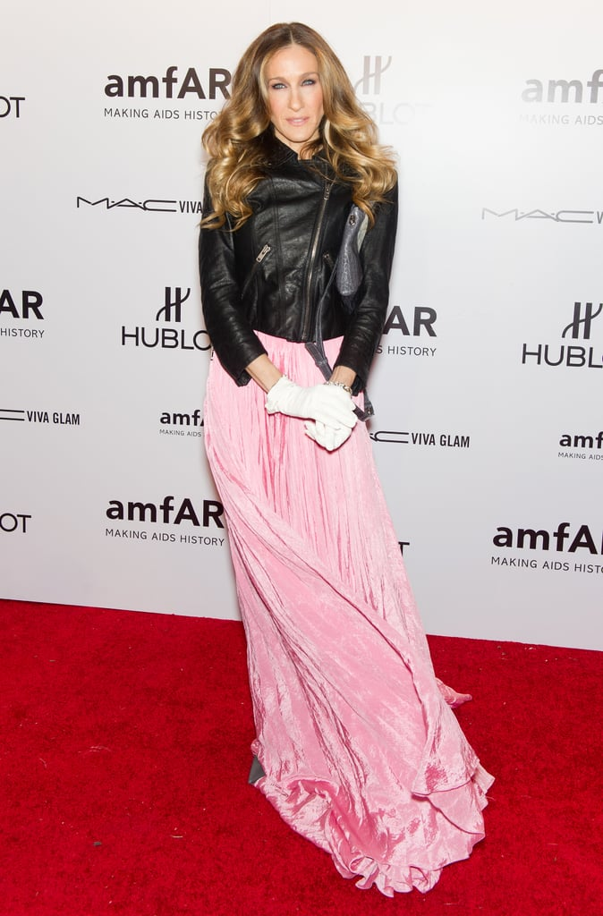 The always-innovative SJP fused trends in a fluttering pink Oscar de la Renta gown, Theyskens' Theory leather motorcycle jacket, and white gloves at the 2012 amfAR Gala in NYC.