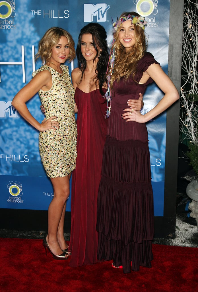 In a pretty 3.1 Phillip Lim dress at the party for The Hills Season 4 finale in December 2008 (with co-stars Audrina and Whitney).