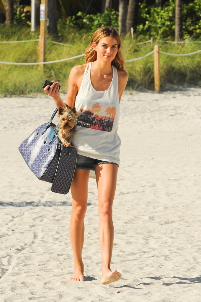 Jessica Hart paired a summery singlet and denim for a day at the beach.