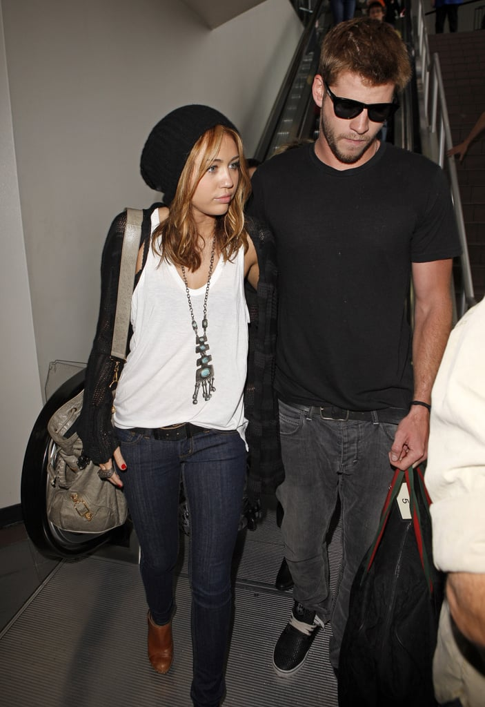 Miley Cyrus and Liam Hemsworth stuck together at LAX in June 2010.