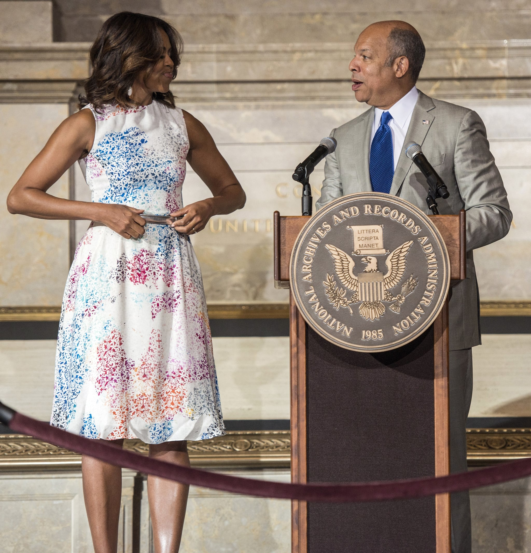 Michelle Obama's printed Tanya Taylor tank dress actually took the form of a two-piece set on the designer's Spring 2014 runway. But, we love how Michelle keeps things polished with the simple addition of a silver belt.