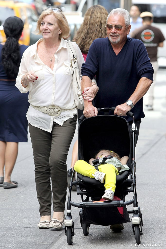 Harper Beckham slept in her stroller during a walk with her grandparents Anthony and Jackie Adams.