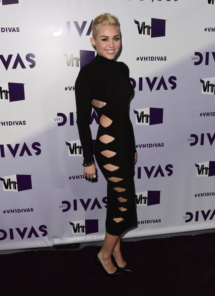 Miley's look for the VH1 Divas concert in December 2012 was definitely one for the books — she showed some skin (and a tattoo) in a skintight Norma Kamali alligator dress with sexy side cutouts.