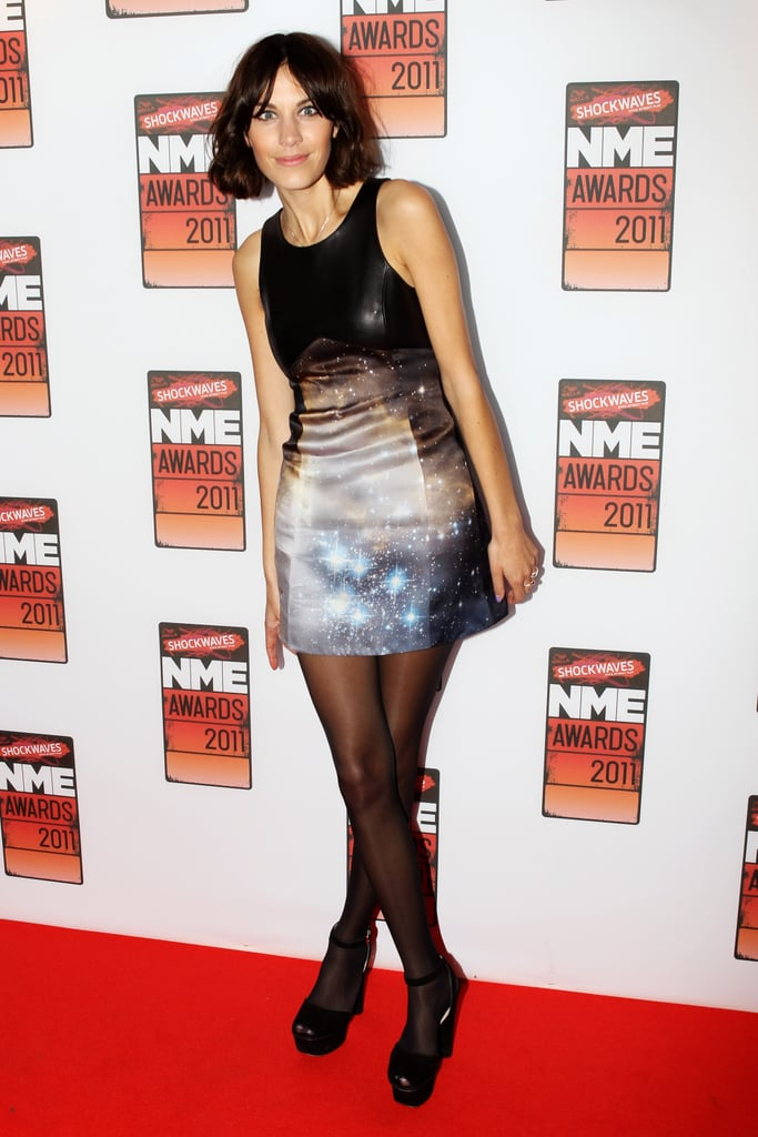 Alexa teamed her Christopher Kane 'galaxy theme'  Resort 2011 Collection mini with black opaque tights and Prada ankle-strap platforms.