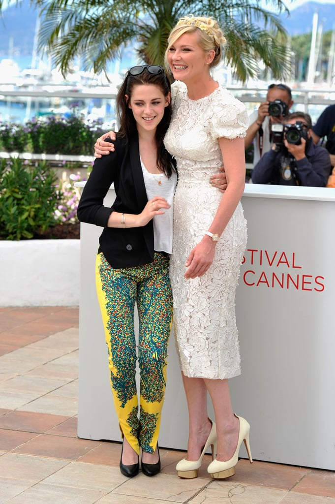 Kristen Stewart and Kirsten Dunst laughed together at the On the Road photocall at the Cannes Film Festival.