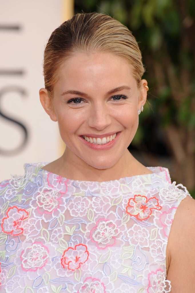 Sienna Miller showed up in a colorful gown for the Golden Globes.