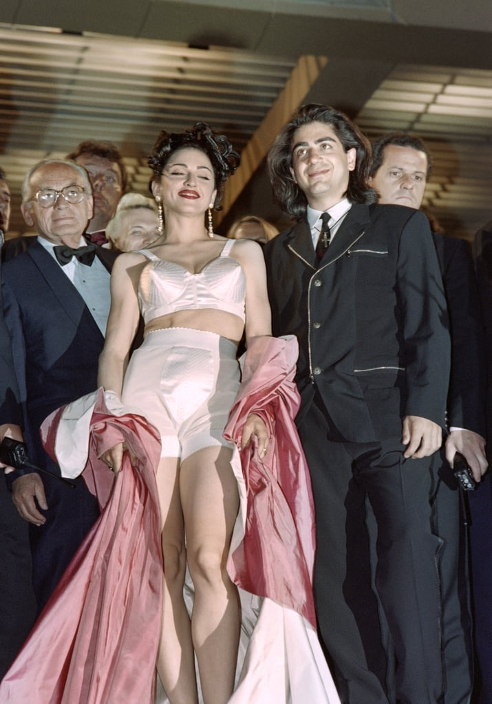 Madonna wore an ensemble designed by Jean Paul Gaultier — including one of the now-iconic cone-shaped bustiers he created for her — at the 1991 Cannes premiere of her movie In Bed With Madonna.