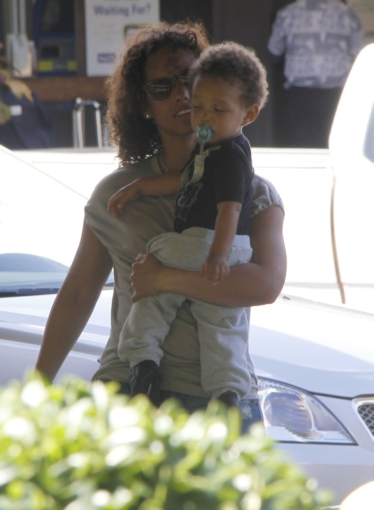 Alicia Keys held Egypt in her arms arriving at the airport.