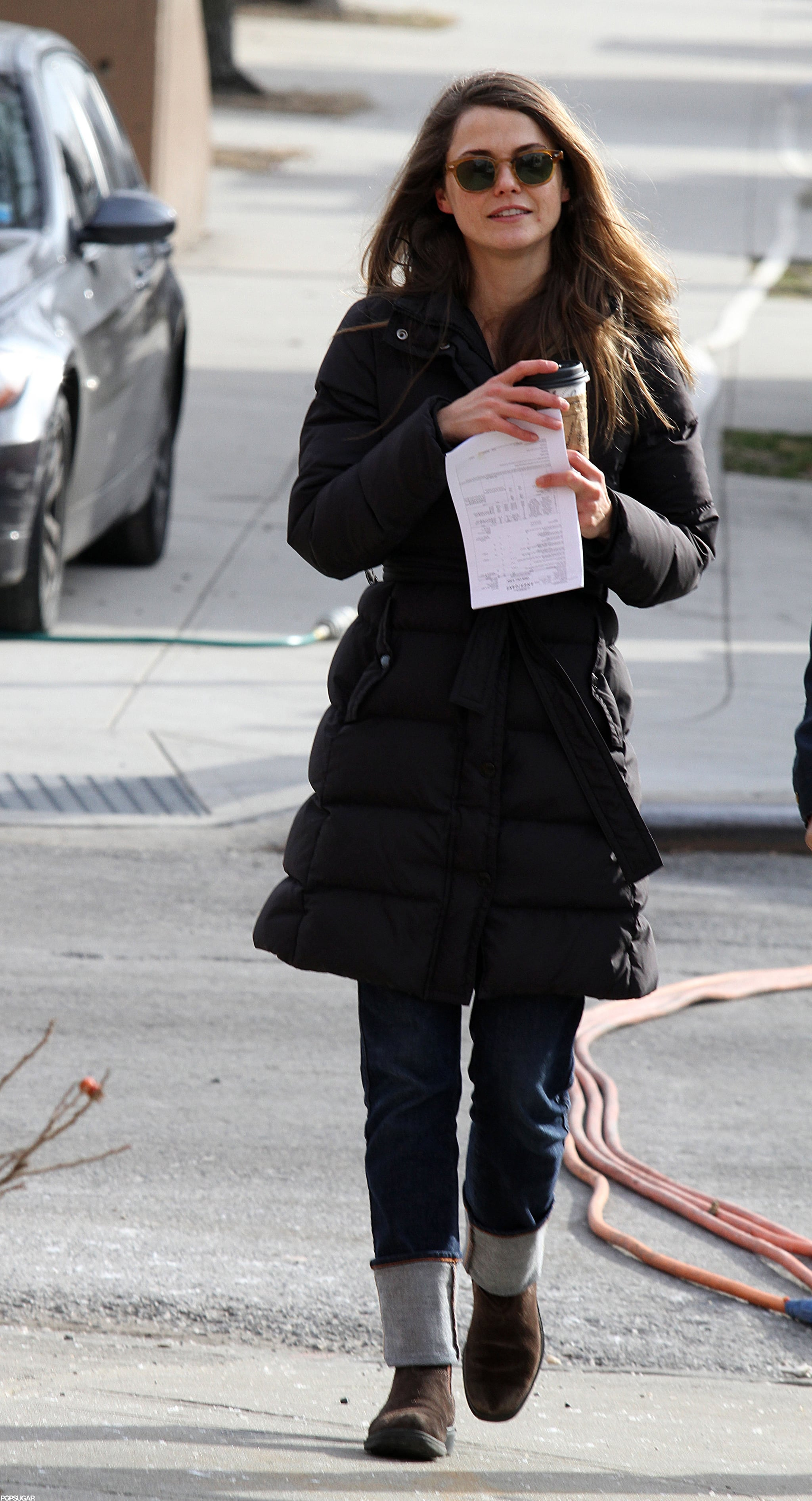 Keri Russell carried her coffee and a piece of paper.