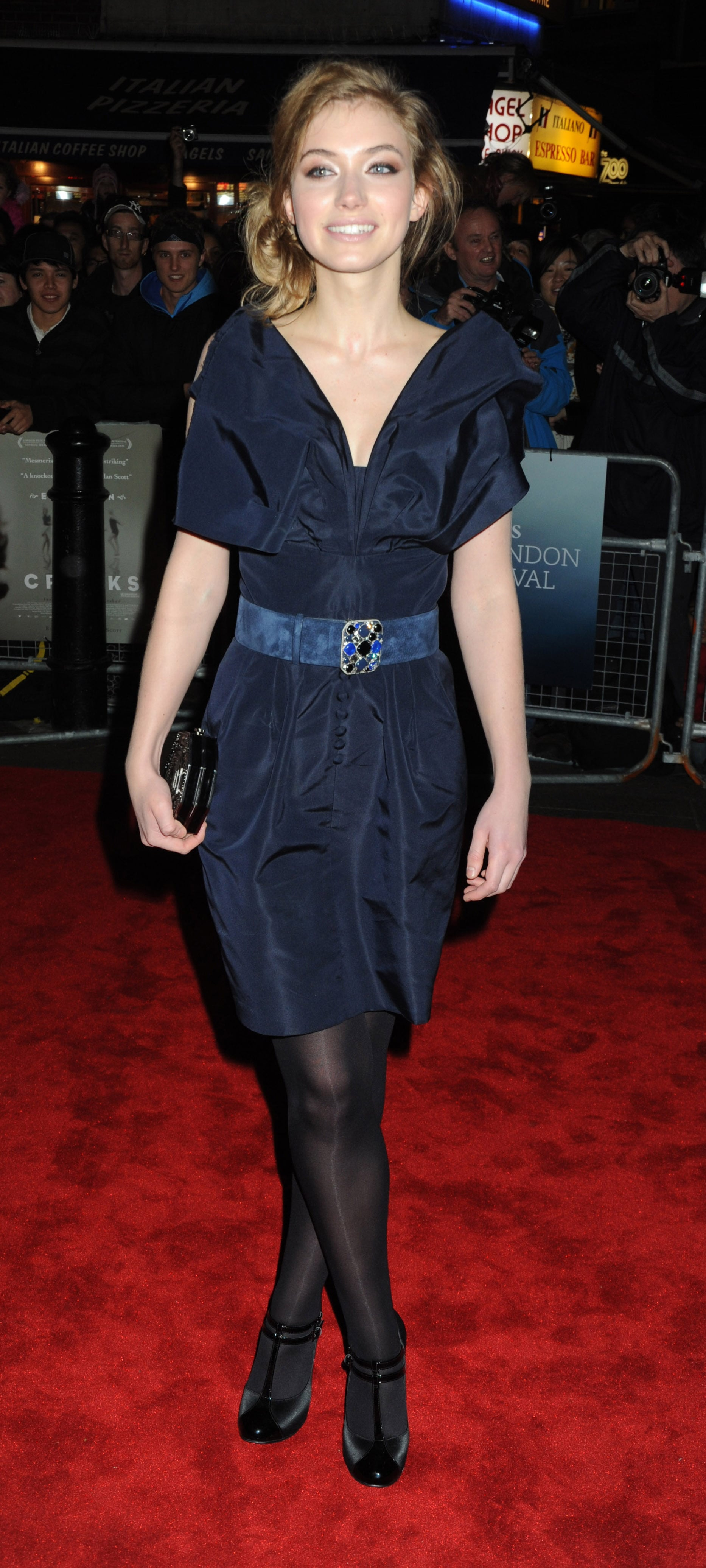 For an appearance at the BFI London Film Festival in 2009, a very young Imogen wore a simple navy dress and belt.