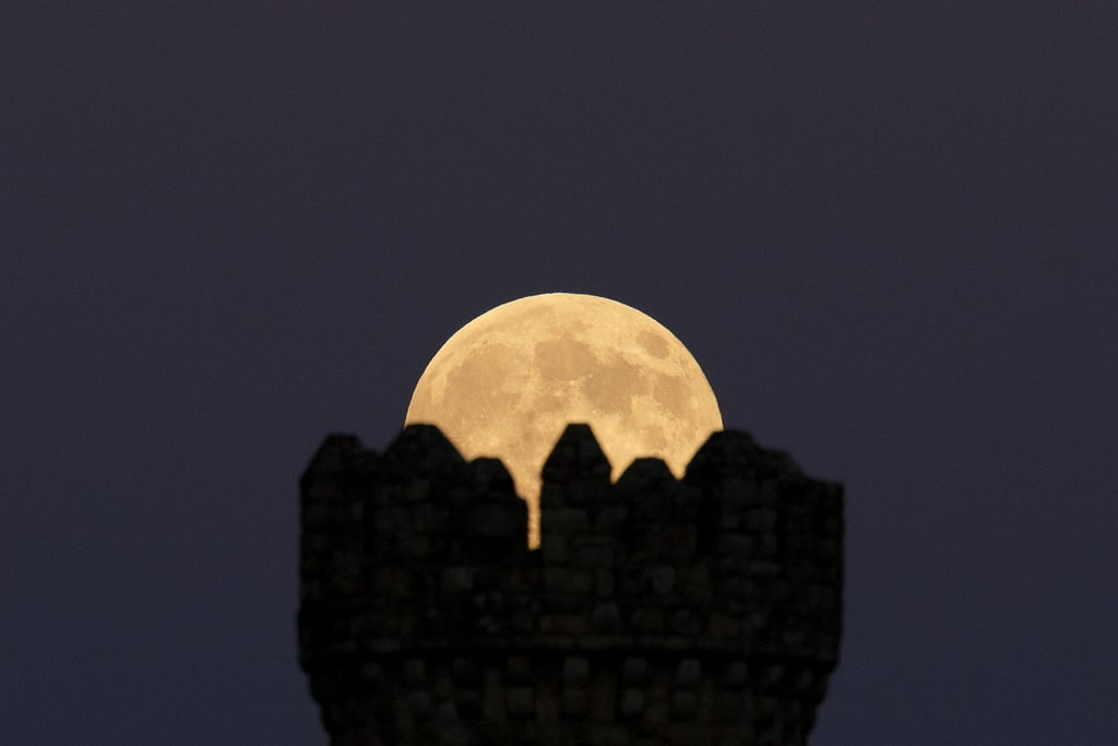 The supermoon aligns perfectly with the Torrelodones Tower on Aug. 10.